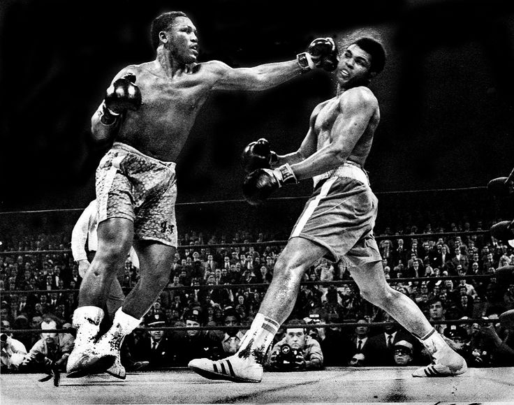 Joe Frazier lands his trademark left hook on Muhammad Ali