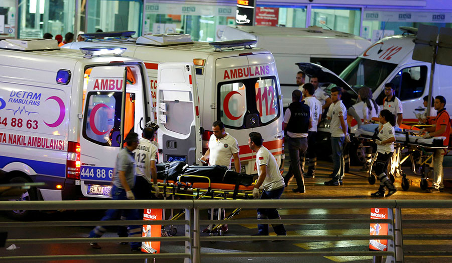 Paramedics push a stretcher at Turkey`s largest airport, Istanbul Ataturk, Turkey, following a blast June 28, 2016. (Osman Orsal / Reuters)