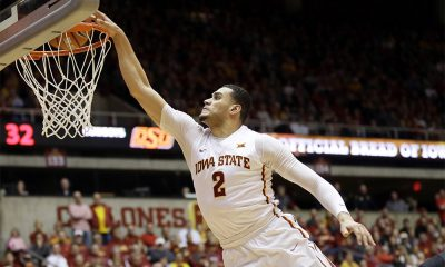 Iowa State forward Abdel Nader (2) dunks over Oklahoma State forward Mitchell Solomon during the second half of an NCAA college basketball game, Monday, Feb. 29, 2016, in Ames, Iowa. (AP Photo/Charlie Neibergall)