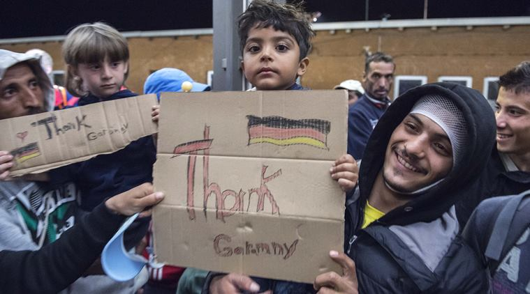 Refugees arrive at the train station in Saalfeld, central Germany, Saturday, Sept. 5, 2015. (AP Photo/Jens Meyer)