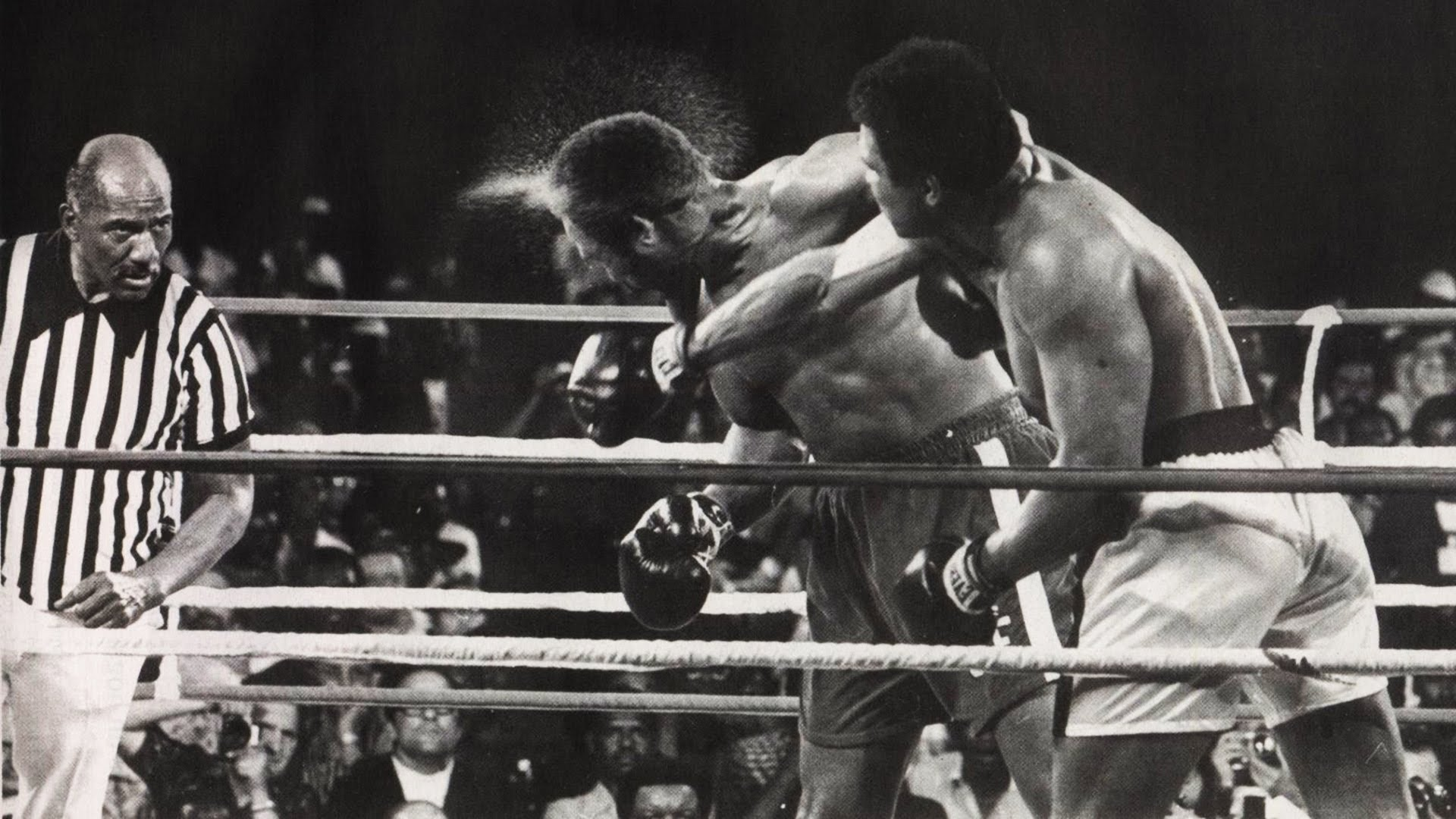 Ali lands a quick right lead on George Foreman in the Rumble in the Jungle