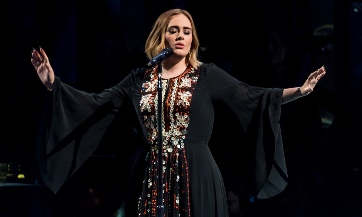 Adele at the Pyramid stage at Glastonbury wearing a Siwa-inspired dress.