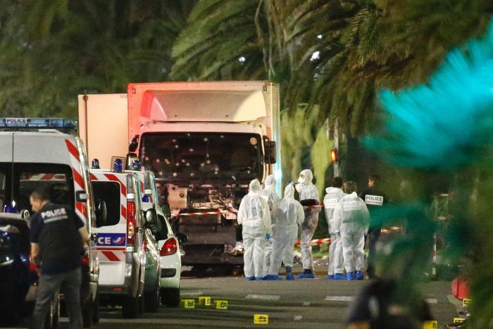 French police and forensic officers near the truck that ran into the crowd (Reuters: Eric Gaillard)