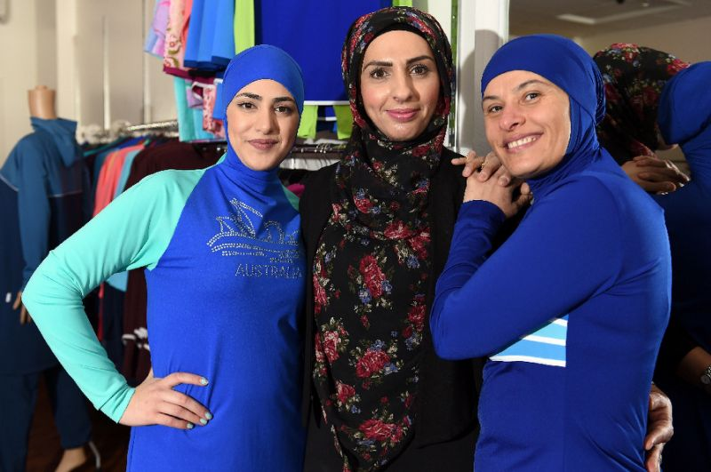 Models show off different burkini styles at a store in Australia