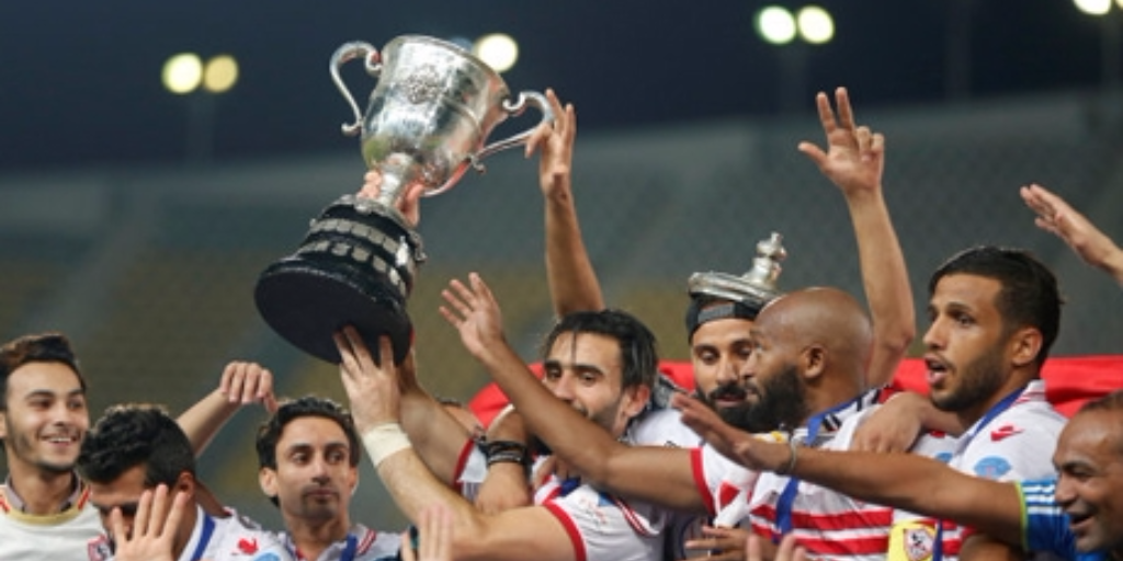 El Zamalek players celebrate with the trophy after winning their Egyptian Cup finals derby soccer match against Al Ahly. (REUTERS)