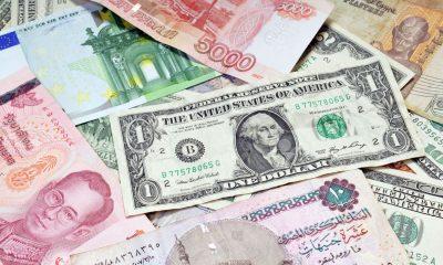6895483-money-of-the-world-dollars-euros-russian-roubles-thai-baht-turkish-lira-egypt-pounds-stock-photo
