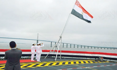 Egyptian Navy officials raising the country's flag on its first-ever French Mistral helicopter carrier, named after late president Gamal Abdel Nasser, June 2, 2016 (Photo: Al-Ahram)