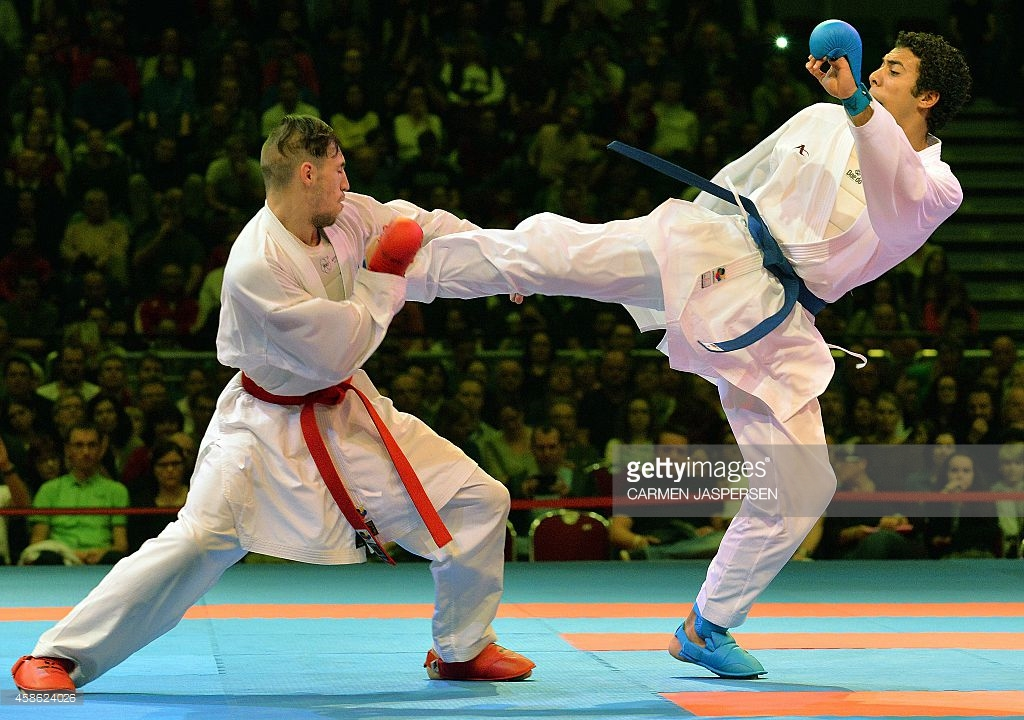 Horuna Stanislav (L) from the Ukraine fights against his opponent Omar Abdel Rahman from Egypt during the Male Kumite third place 75kg of the 22nd Karate World Championships at OVB-Arena on November 8, 2014 in Bremen, Germany. Photo: CARMEN JASPERSEN/AFP/Getty Images