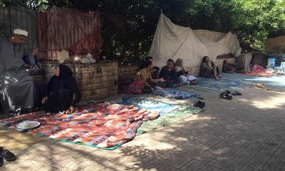 Patients and their relatives waiting outside Qasr al-Ainy Hospital. Photo: Roger Anis