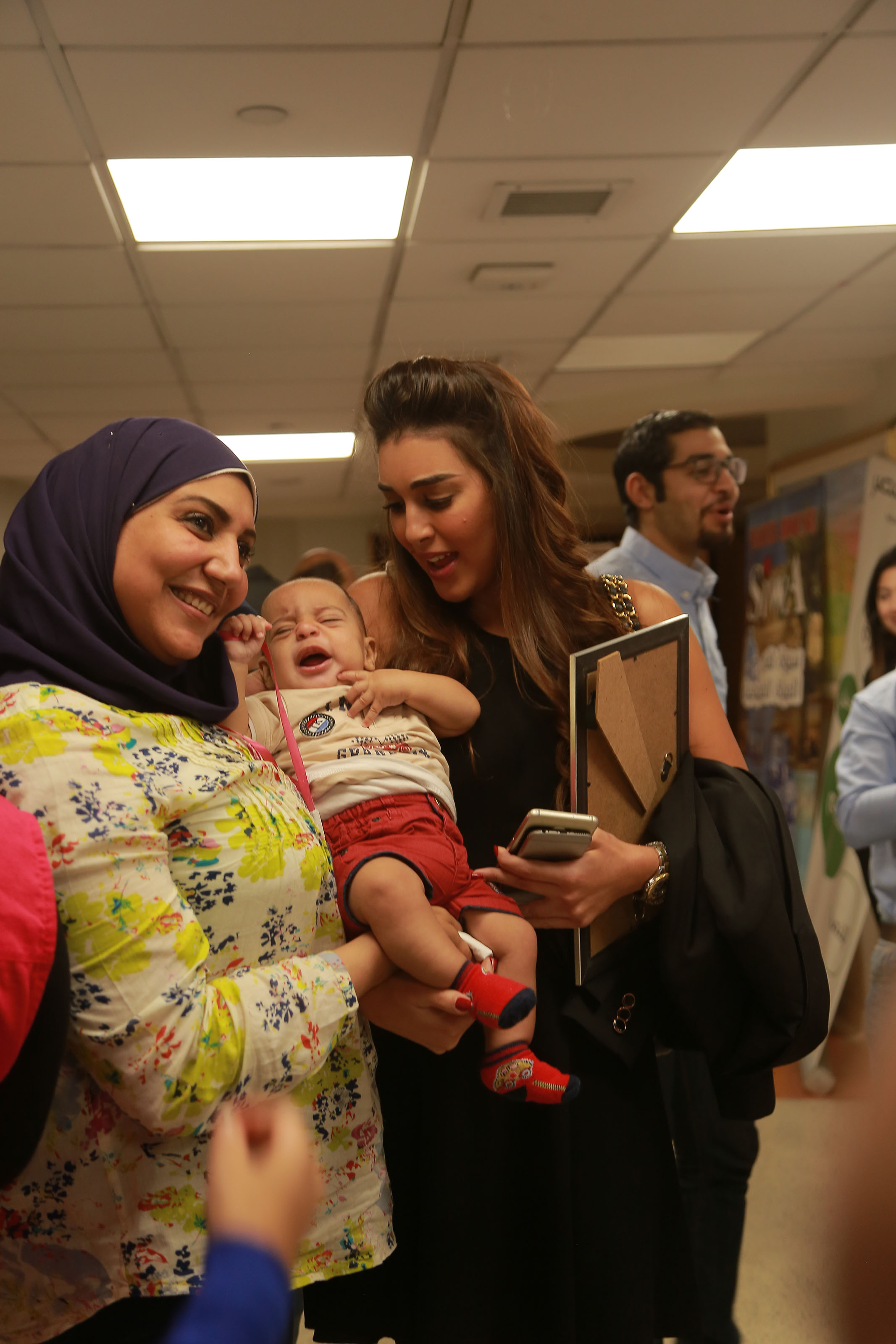 "Actress Yasmine Sabry with attendees at an event held by the Misr Foundation for Health and Sustainable Development at the 57357 Children's Cancer Hospital. Photo courtesy of ""You Are More Important"" campaign"