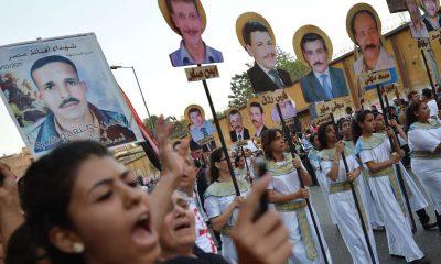 Activists commemorate the victims of the 2011 Maspero massacre