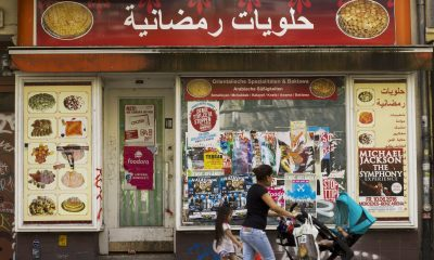 A Ramadan sweets shop advertises its products in Arabic and German