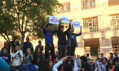 """Students at the American University in Cairo hold up signs that read """"My father is not a thief"""" during a protest against rapidly increasing tuition fees. Photo: Nouran Allam"""