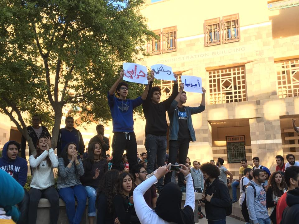 "Students at the American University in Cairo hold up signs that read ""My father is not a thief"" during a protest against rapidly increasing tuition fees. Photo: Nouran Allam"