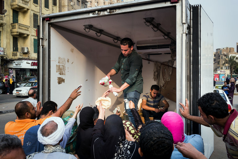 Egyptians gathered in Cairo to buy subsidized sugar from a government truck. A weeks-long sugar shortage has plunged people into a panic. (Photo: David Degner for The New York Times)