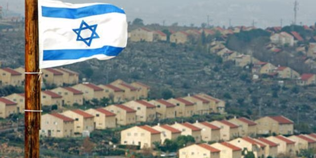 The Israeli flag flying over Israeli settlements in the West Bank (Photo: Reuters)