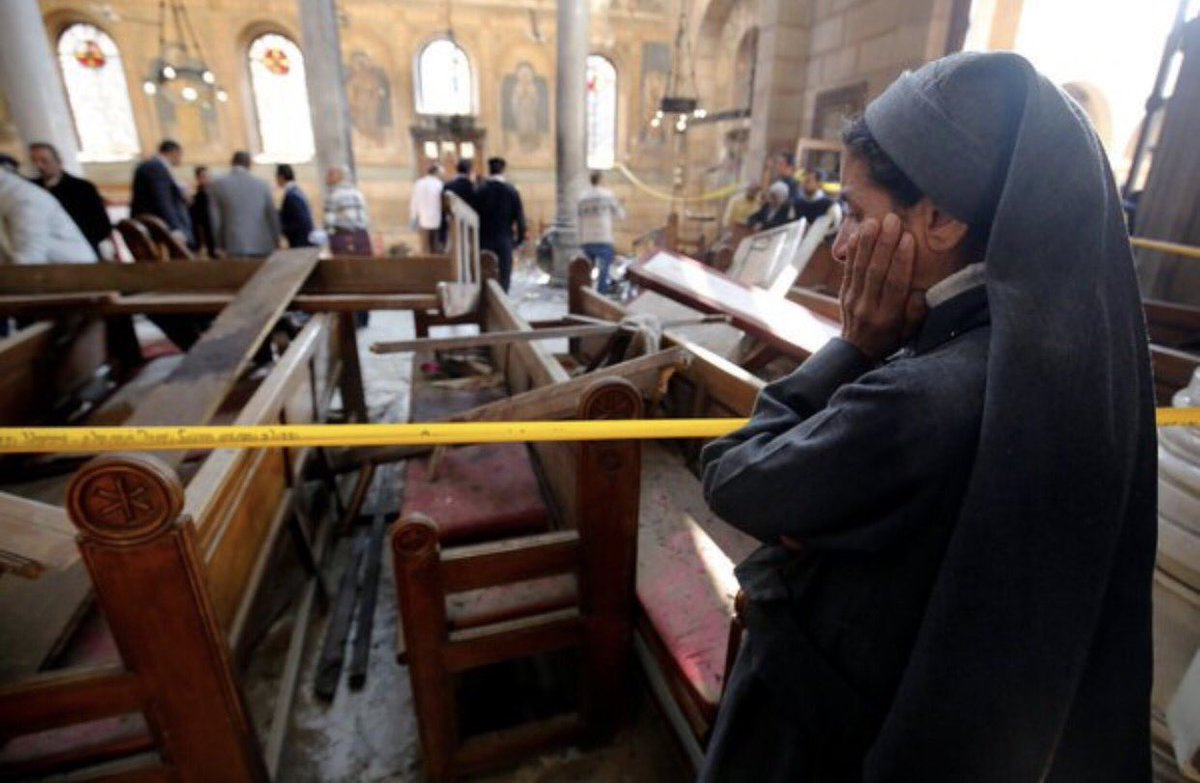 A nun cries as she stands at the scene inside Cairo's Coptic cathedral, following a bombing, in Egypt December 11, 2016. REUTERS/Amr Abdallah Dalsh