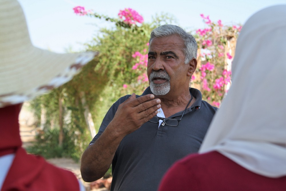 Maged el-Said shows visitors around Habiba Organic Farm. Credit: Enas El Masry