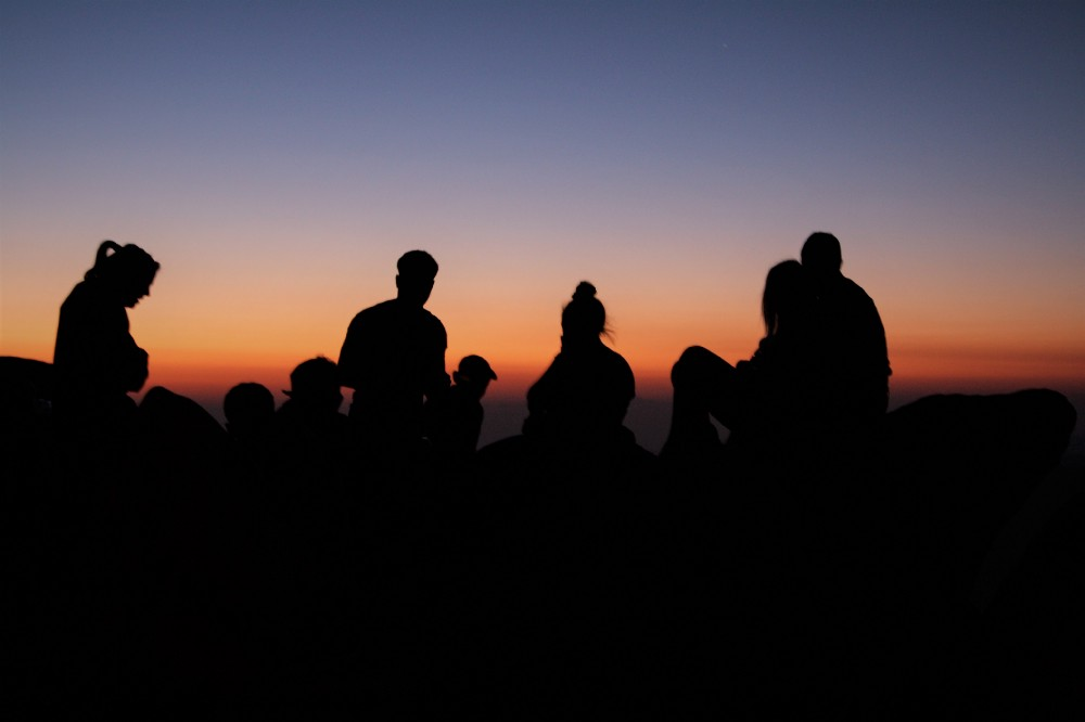 Young hikers await sunrise at the summit of Mount Sinai [Jebel Mousa]. Credit: Enas El Masry