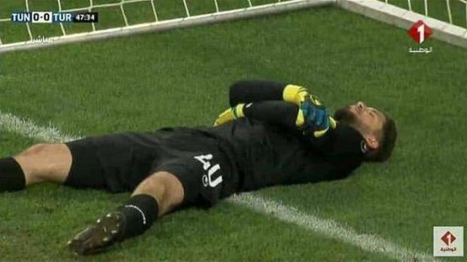 Tunisia's national goalkeeper fakes injury to let teammates break Ramadan fast